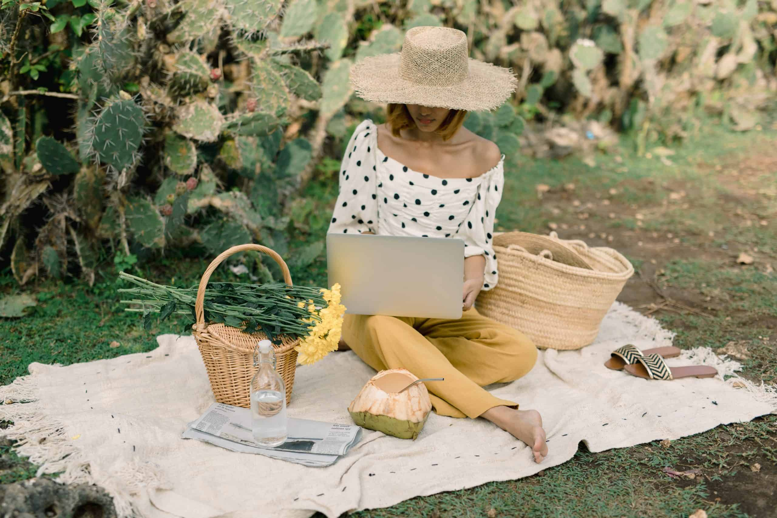 Woman working on laptop outside